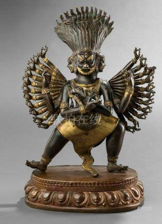 A PARCEL-GILT BRONZE EMBOSSED FIGURE OF A PROTECTIVE DEITY