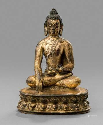 AN INSCRIBED GILT-BRONZE FIGURE OF BUDDHA SHAKYAMUNI