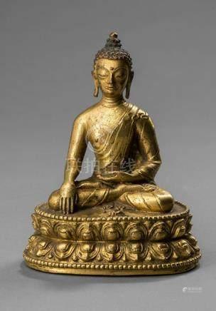 A GILT-BRONZE FIGURE OF BUDDHA AKSHOBHYA