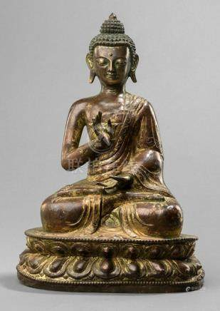 A GILT-COPPER EMBOSSED FIGURE OF BUDDHA SHAKYAMUNI