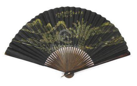 A FAN DEPICTING A GOLDEN LANDSCAPE SCENE ON BLACK GROUND, China, signed: Zhang Yixin and sealed: Hangshen Wangxingji zhi - Property from a German private collection, acquired in China prior 1940 - Slightly damaged