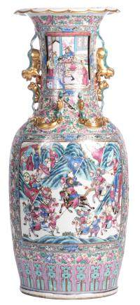 A Chinese famille rose floral and relief decorated vase, the roundels with court scenes and warriors, 19thC, H 89 cm