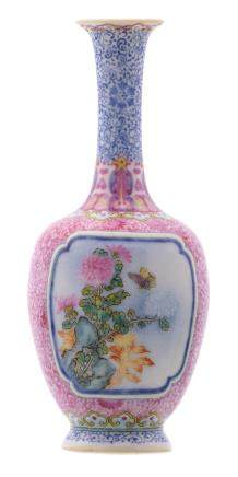 A Chinese famille rose miniature bottle vase, floral decorated, the roundels with a rock, a butterfly and flower branches, with a Qianlong mark, H 14 cm