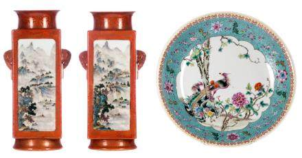 A pair of Chinese orange ground polychrome decorated quadrangular vases with mountainous river landscapes and calligraphic texts, Daoguang marked, H 36,5 cm; added a Chinese polychrome and famille rose decorated plate with floral motifs, birds and flower branches, marked, ø 37 cm