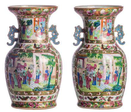 A pair of Chinese famille rose floral decorated Canton vases, the roundels depicting the Eight Immortals and animated scenes, H 34 cm