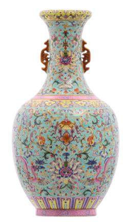 A Chinese turquoise ground famille rose vase, floral decorated with mythological animals and symbols of prosperity, with a Jiaqing mark, H 34 cm