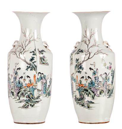 A pair of polychrome decorated Chinese vases, with an elegant garden scene and calligraphic texts, H 57,5 cm