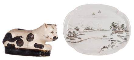 A glazed stoneware Japanese head-rest modelled as a cat, H 18 - W 34 cm; added a Japanese polychrome decorated dish depicting a winter landscape, marked, Meiji, 29,5 x 38 cm