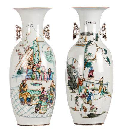 Two Chinese vases, polychrome and famille rose decorated, with an animated scene, playing children and calligraphic texts, H 59 cm