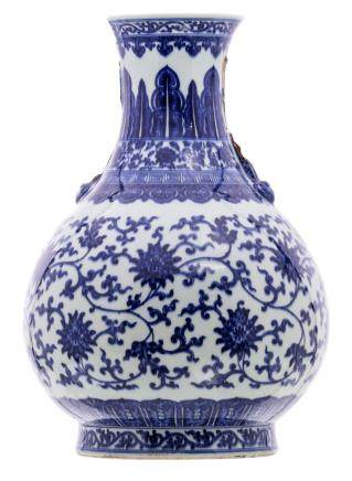 A Chinese blue and white lotus decorated pear shaped vase, Qianlong marked and possibly period, H 52 cm