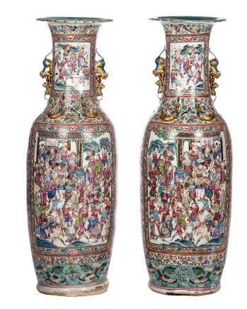 A pair of impressive Chinese famille rose vases, relief decorated with dragons and phoenix, the roundels with court scenes and warriors, 19thC, H 135 cm