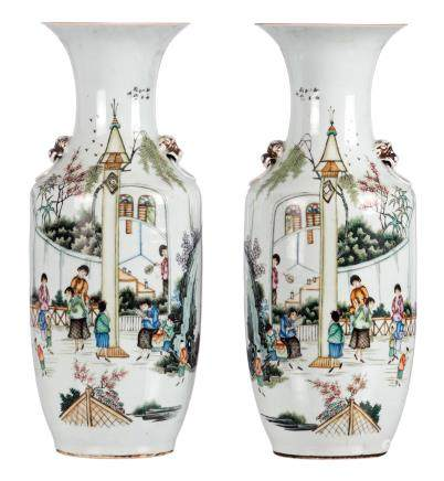 A pair of polychrome decorated vases, with an animated scene and calligraphic texts, H 58 cm
