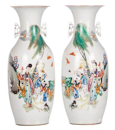 A pair of Chinese polychrome decorated vases with a lady and boys playing in a garden and calligraphic texts, H 58 - 58,5 cm