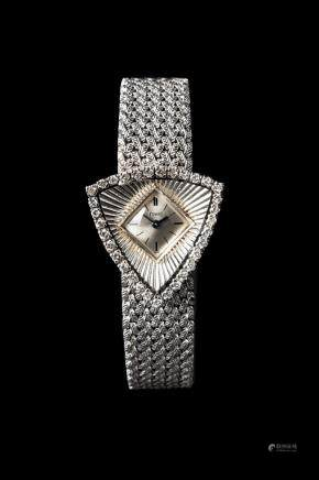 Piaget ,  Fine lady's 18K White Gold & Diamond Set , Manual winding.
