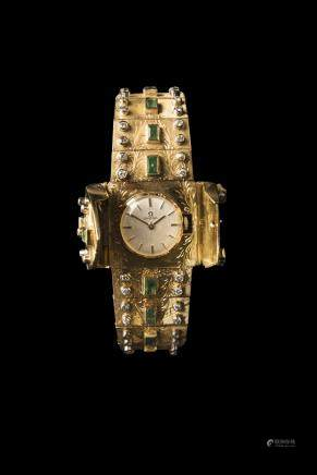 Omega , 18 K gold, high quality, 3 ct diamonds and 6 ct emeralds, cover in center manual winding