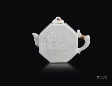 A Blanc de Chine Dehua octagonal teapot with inscription and blossom branches, China, Qing Dynasty, Kangxi Period (1662-1722)
