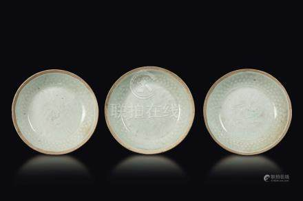 Three glazed stoneware small dishes with decoration in relief, China, Song Dynasty (960-1279)