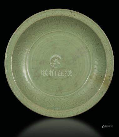 A large Longquan Celadon dish with naturalistic decoration, China, early Ming Dynasty