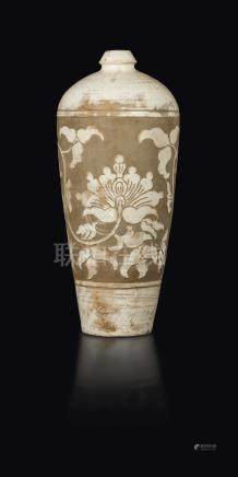 A Chizou Meiping vase with lotus flowers in relief, China, Northern Song Dynasty (960-1127)