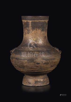 A pottery vase with mask handles, China, Han Dynasty (206-220)