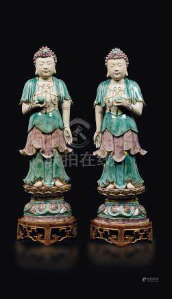 A pair of glazed bisquit figures of standing Buddha with peaches, China, Qing Dynasty, Kangxi Period (1662-1722)