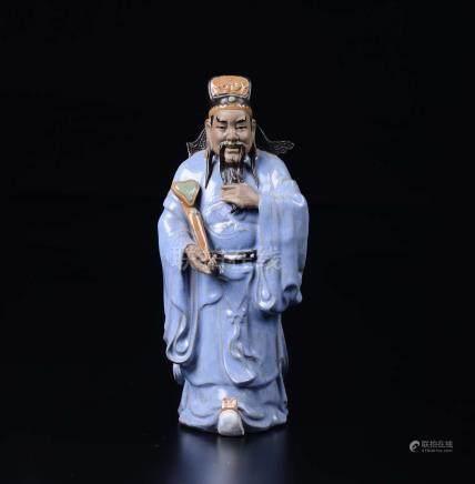 A glazed pottery figure of dignitary with ruyi, China, ...