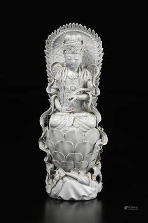 A Blanc de Chine figure of Guanyin with ruyi on lotus ...