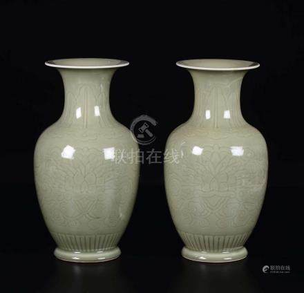 A pair of Celadon porcelain vases with lotus flowers, ...