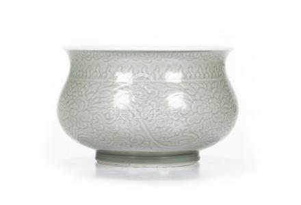 Celadon porcelain basin with carved stylized floral ...