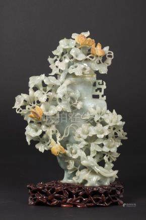 A green jade vase with naturalistic decoration in relief, China, Qing Dynasty, late 19th century