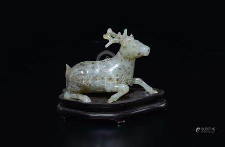 A white and russet jade figure of a deer, China, Qing Dynasty, 19th century