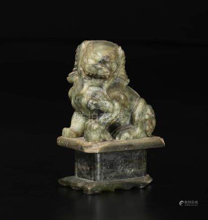 A green and russet jade figure of Pho dog, China, 20th century