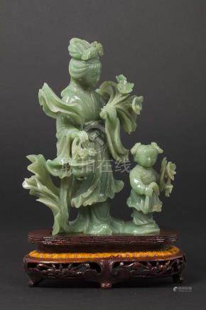 A jadeite Guanyin and child group, China, early 20th century