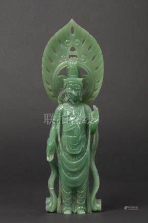 A jadeite figure of deity with aura, China, early 20th century