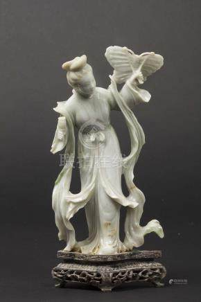 A jadeite figure of Guanyin with butterfly kite, China, early 20th century
