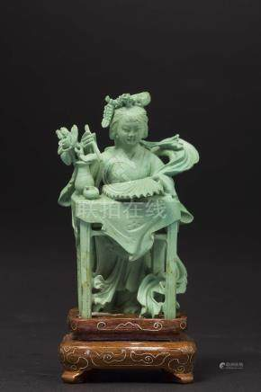 A small turquoise figure of Guanyin, China, Qing Dynasty, late 19th century