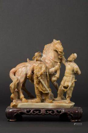 A soapstone horse and horsemen group, China, early 20th century