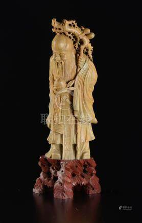 A soapstone figure of wise man with fruit and inscription, China, 20th century