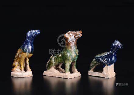 Three glazed pottery figures, two dogs and a pheasant, China, Qing Dynasty, 19th century