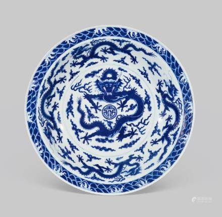 A RARE AND LARGE IMPERIAL BLUE AND WHITE 'DRAGON' DISH QIANLONG SEAL MARK IN UNDERGLAZE BLUE AND OF THE PERIOD