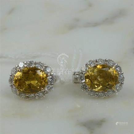Paire de boucles d'oreilles clips en or blanc 18 carats sert