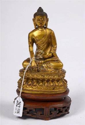 """""""Bouddha assis sur une fleur de lotus"""" en bronze doré sur un"""