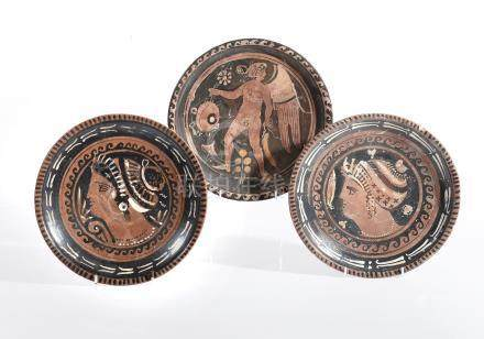 Three Apulian red-figure dishes, Greek South Italy, circa 4th century BC, each on a raised ring