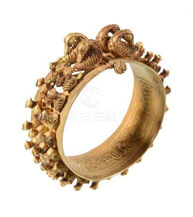 A gold granulated bangle, Abbasid/Ilkhan period, the bangle with three rows of granulated birds to