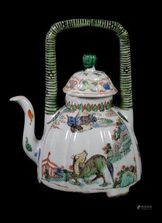 A Chinese Famille Verte wine pot and a cover , Kangxi, the fluted dome shaped body supported on
