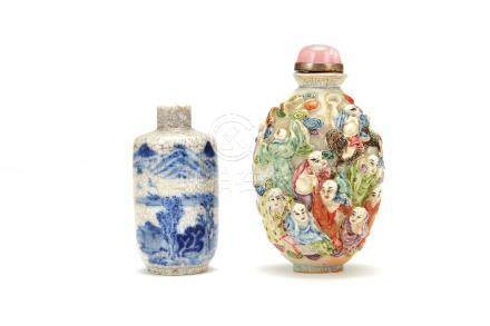 A Chinese Famille Rose snuff bottle, the exterior moulded with figures and painted in coloured