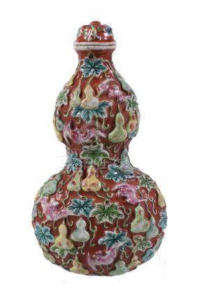 A rare large Chinese moulded porcelain 'double-gourd and bats' snuff bottle and stopper, Qing