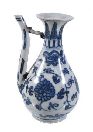 A Chinese blue and white ewer, late Ming Dynasty, the pear-shaped body of the ewer painted with a