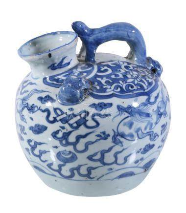 A Chinese blue and white ewer, 17th century, the ovoid body with zoomorphic overhead handle and
