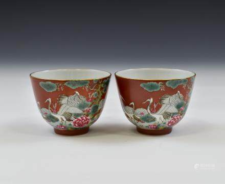 PAIR OF QIANLONG VERMILLION RED BOWLS IN CRANES MOTIF